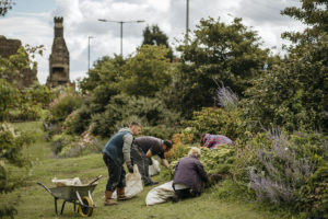Volunteers gardening in the Tudor grounds at Sheffield Manor Lodge